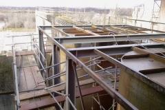 Neubau einer Stahlkonstruktion für eine Arbeitsbühne zwischen zwei Silos - Schrader Montage GmbH Beckum